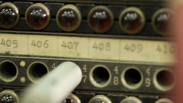 Macro shot as camera moves up across the cables and sockets on an old telephone switchboard Royalty-free stock video