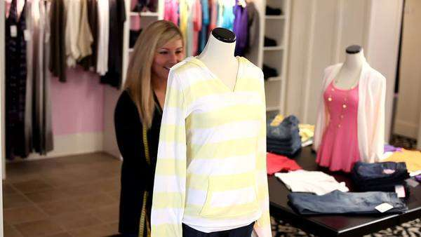 Woman fits manikin with clothing Royalty-free stock video