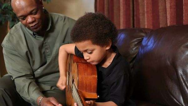 Father teaches his son to play guitar Royalty-free stock video