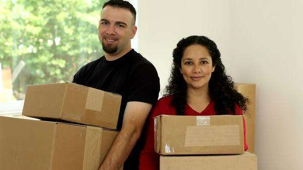 Couple in new home with boxes Royalty-free stock video