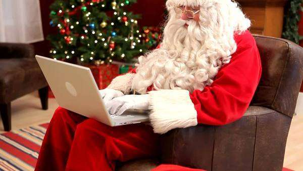 Santa Claus with laptop computer Royalty-free stock video