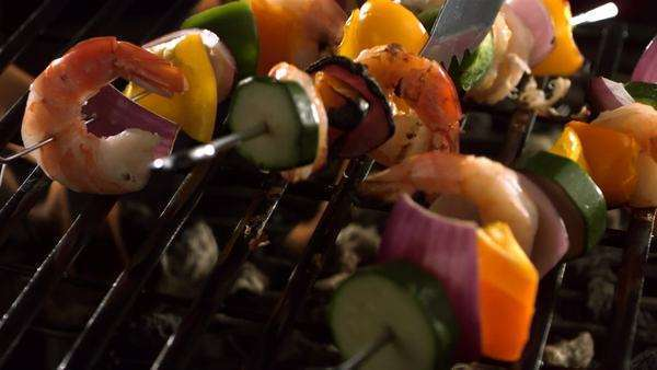 Shrimp and vegetable skewers on grill Royalty-free stock video
