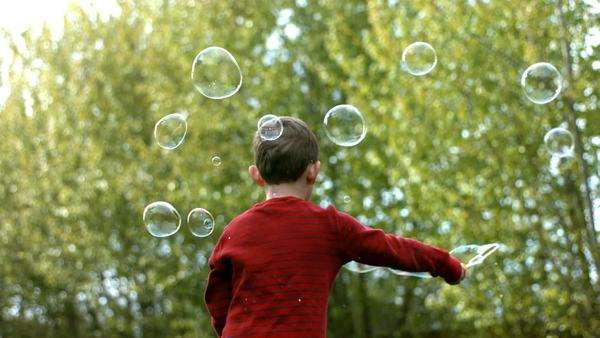 Young boy making bubbles, slow motion Royalty-free stock video