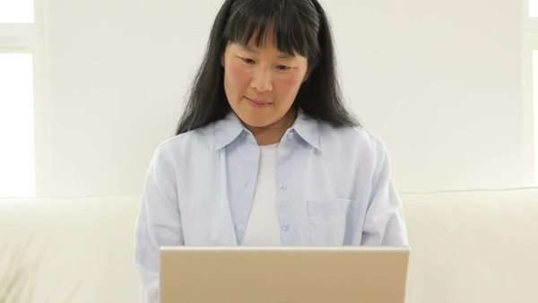 Mature Asian woman with laptop computer Royalty-free stock video
