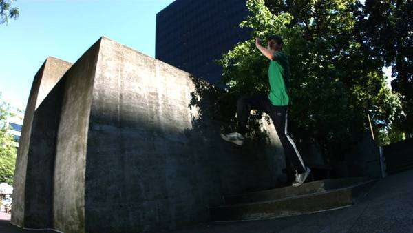 Free runner jumps off concrete wall, slow motion Royalty-free stock video