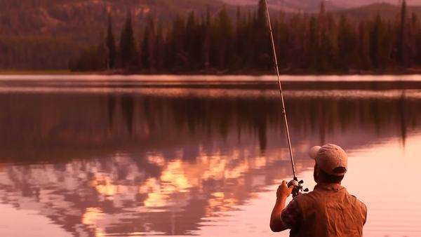 Man in canoe fishing at dusk Royalty-free stock video