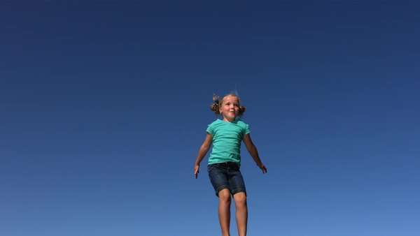 Young girl jumping on trampoline, slow motion Royalty-free stock video