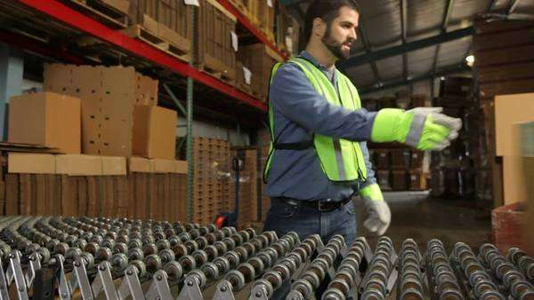 Delivery man processing packages in warehouse Royalty-free stock video