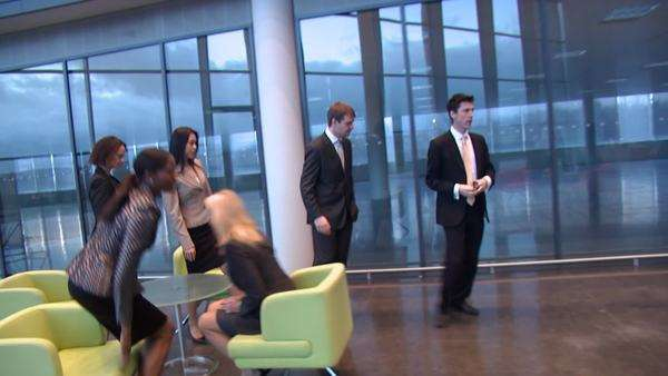 Manager welcomes business staff and escorts them through offices Royalty-free stock video