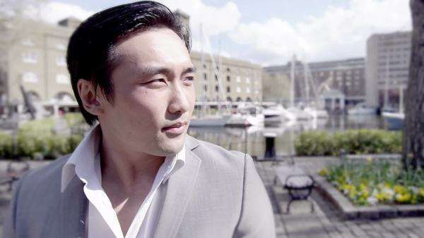 Portrait of a young handsome Asian man outdoors in the city Royalty-free stock video