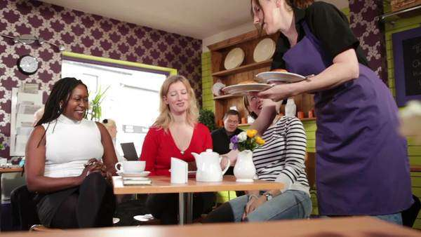 Group of women enjoying tea in a café Royalty-free stock video