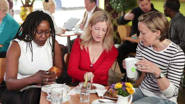 Women eating in a café Royalty-free stock video