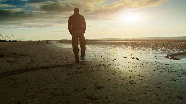 Man alone, walking along the beach at sunset Royalty-free stock video