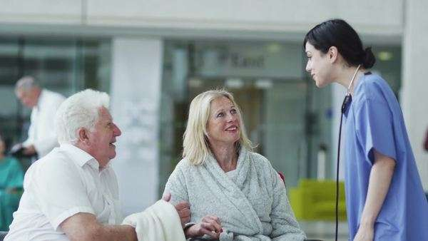 Woman comforted by caring medical staff Royalty-free stock video
