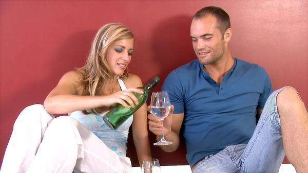 Attractive young couple smiling and talking to each other, while pouring a glass of wine and drinking Royalty-free stock video