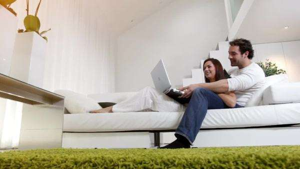 Couple relaxing and browsing Internet Royalty-free stock video
