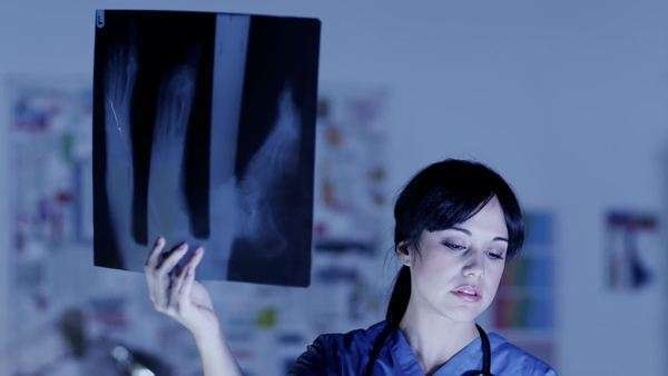 Surgeon or doctor examines x-ray images Royalty-free stock video