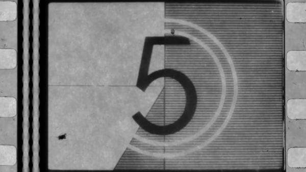 universal film/academy leader countdown, made using 35mm celluloid film strip. Royalty-free stock video