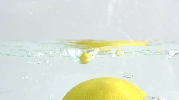 fresh lemon fruit dropped into water shot in super slow motion with the Sony FS700 high speed camera Royalty-free stock video