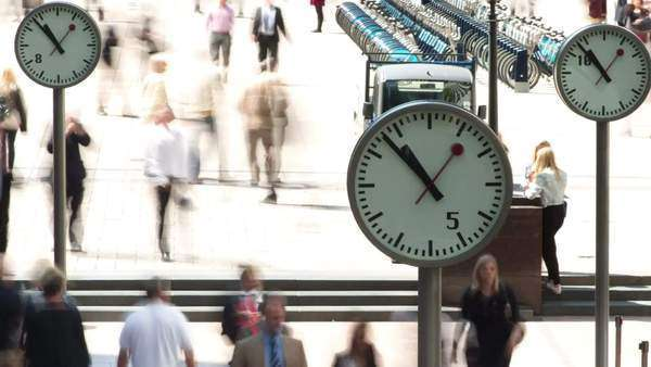 timelapse of business people going to work in London dockland financial district, with iconic clocks Royalty-free stock video