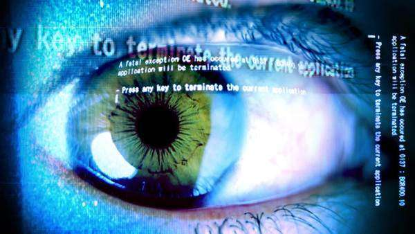 close-up of eye with computer data and text overlaid Royalty-free stock video