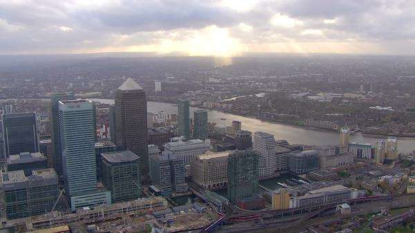 Aerial view above the distinctive towers of London's financial district, Canary Wharf. Royalty-free stock video