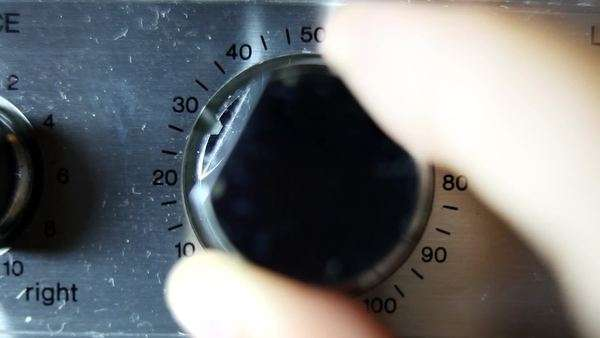 close-ups of hand turning a volume control on an old hifi Royalty-free stock video