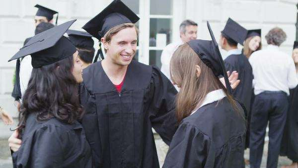 Group of student friends on graduation day standing Royalty-free stock video