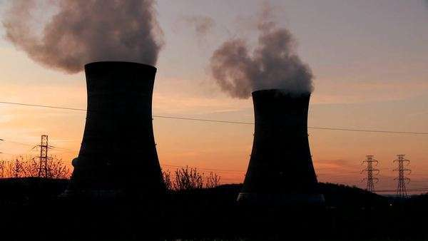 Sunset behind a nuclear power plant. Royalty-free stock video