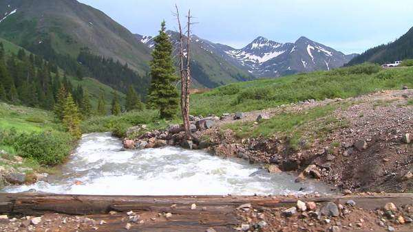 Rocky Mountain river and mountains, from a bridge. Royalty-free stock video
