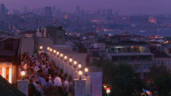 People eating dinner at a rooftop restaurant overlooking Istanbul, Turkey. Royalty-free stock video