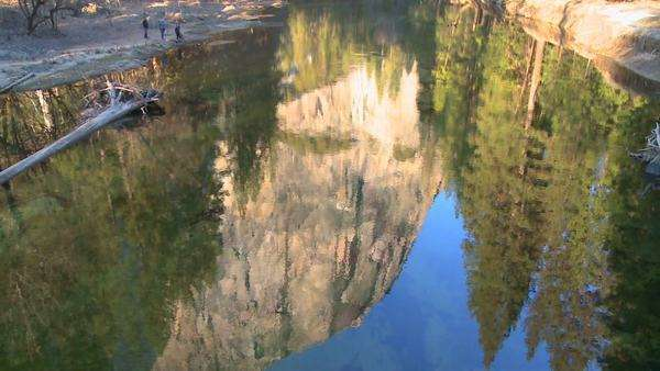 El Capitan is reflected in the Merced River in Yosemite National Park. Royalty-free stock video