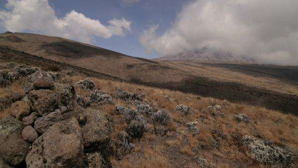 Kilimanjaro, clouds  above, rocks in front Royalty-free stock video