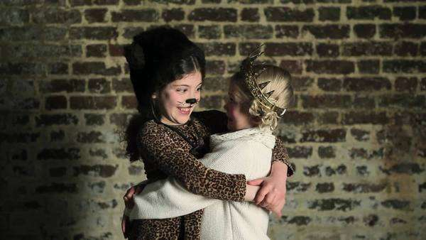 Two young girls in dressing up clothes, hugging Royalty-free stock video