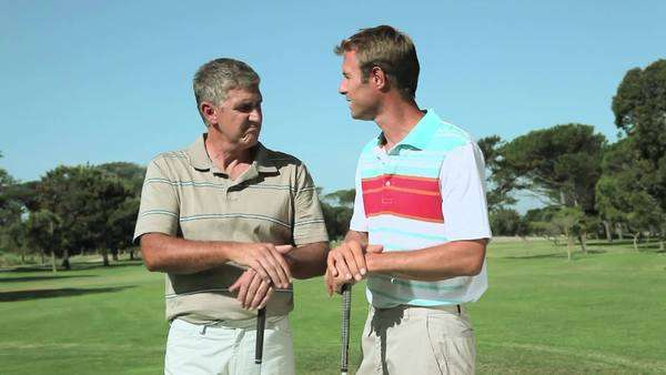 Mature men chatting on golf course Royalty-free stock video