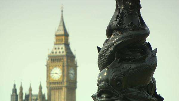 Lamppost with fish decoration and houses of parliament Royalty-free stock video