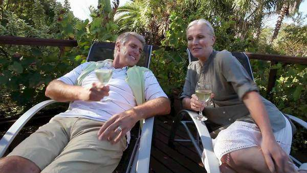 Couple sitting on garden chairs with wine Royalty-free stock video