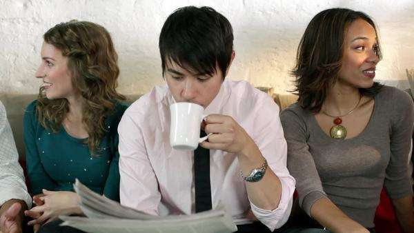 Young people in cafe, man reading newspaper and drinking coffee Royalty-free stock video