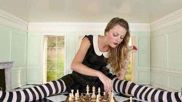 Young woman playing chess in small room, zoom in Royalty-free stock video
