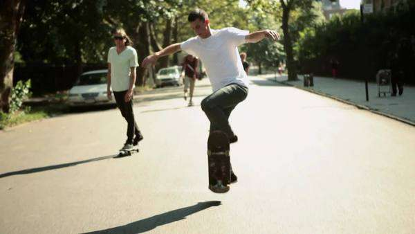 Young people skateboarding in street Royalty-free stock video
