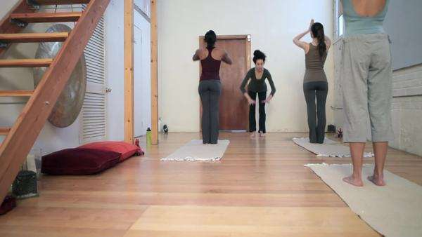 Women doing yoga class with instructor Royalty-free stock video