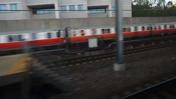 View from train as it passes train station platform Royalty-free stock video