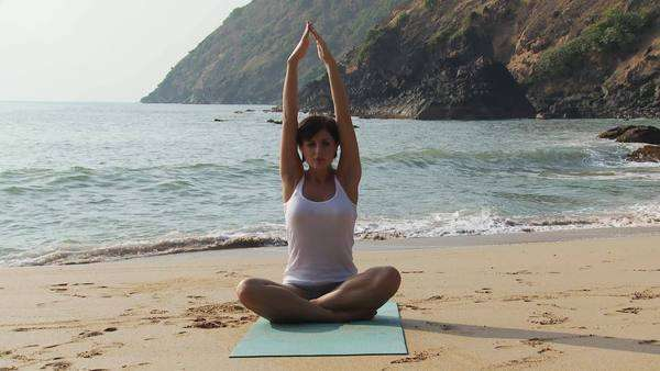 Woman practicing yoga by the ocean Royalty-free stock video