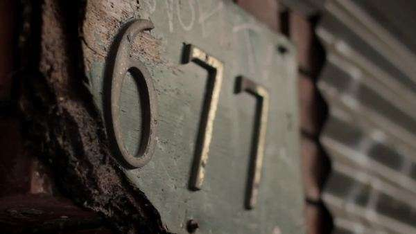 Close-up on house number 677 Royalty-free stock video