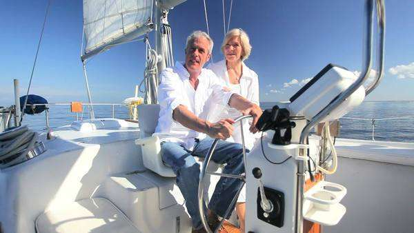 Portrait of a healthy retired couple enjoying leisure aboard their luxury sailing boat Royalty-free stock video