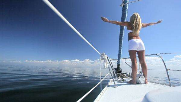 Beautiful blonde girl enjoying the jet set lifestyle aboard a luxury yacht Royalty-free stock video