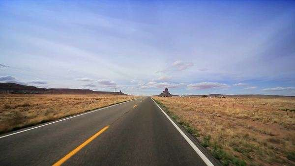 Driving the long straight road through the desert to Monument Valley, Arizona Royalty-free stock video