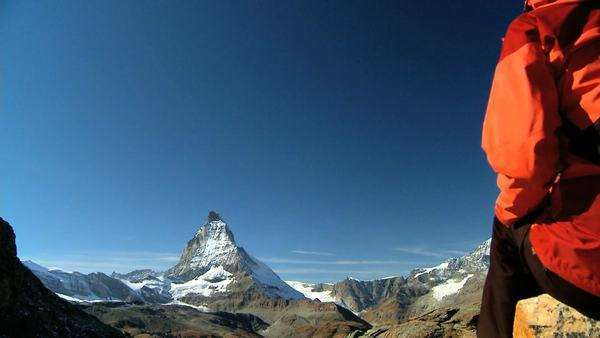 Female hiker enjoying view of the Matterhorn, Switzerland Royalty-free stock video