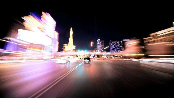 Timelapse point of view of traffic and neon lights on the streets of Las Vegas at night Royalty-free stock video