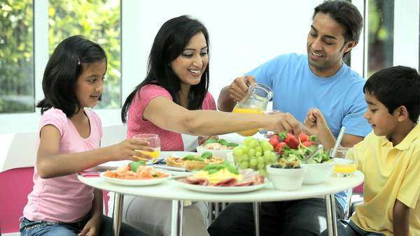Young Asian family sharing a healthy lunch together Royalty-free stock video